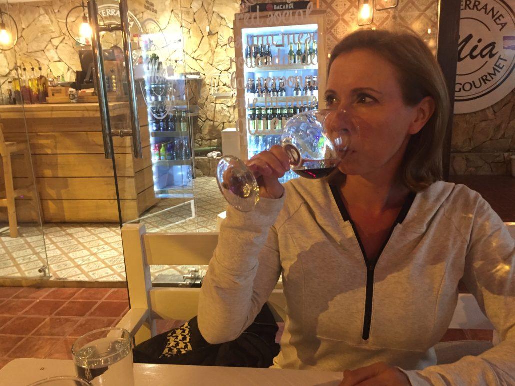 Amelia Drinking Wine at Mia Pizza